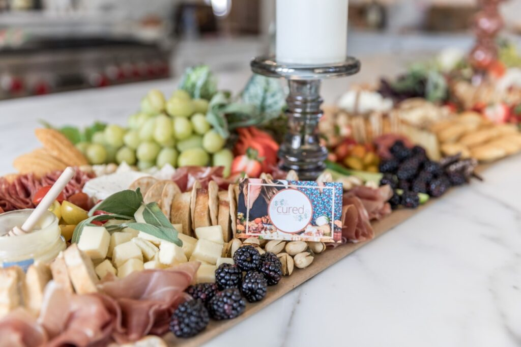 Cured and Company is a north Alabama-based charcuterie board business that crafts custom, varied, fresh options delivered to your door complimentary.