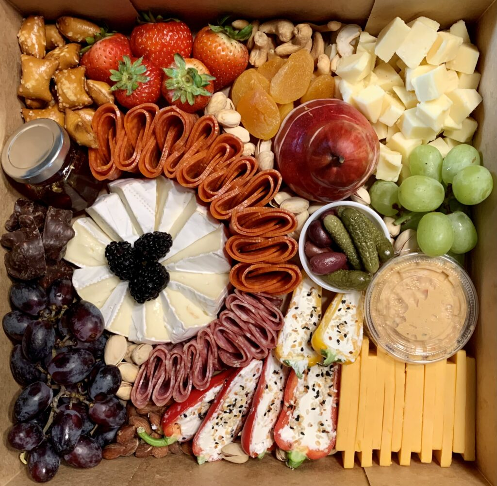 It's All Gouda is a home-delivery charcuterie board business where De Leon uses the highest-quality ingredients that she can find to create attractive, tasty boards for families and party sizes of all kinds.