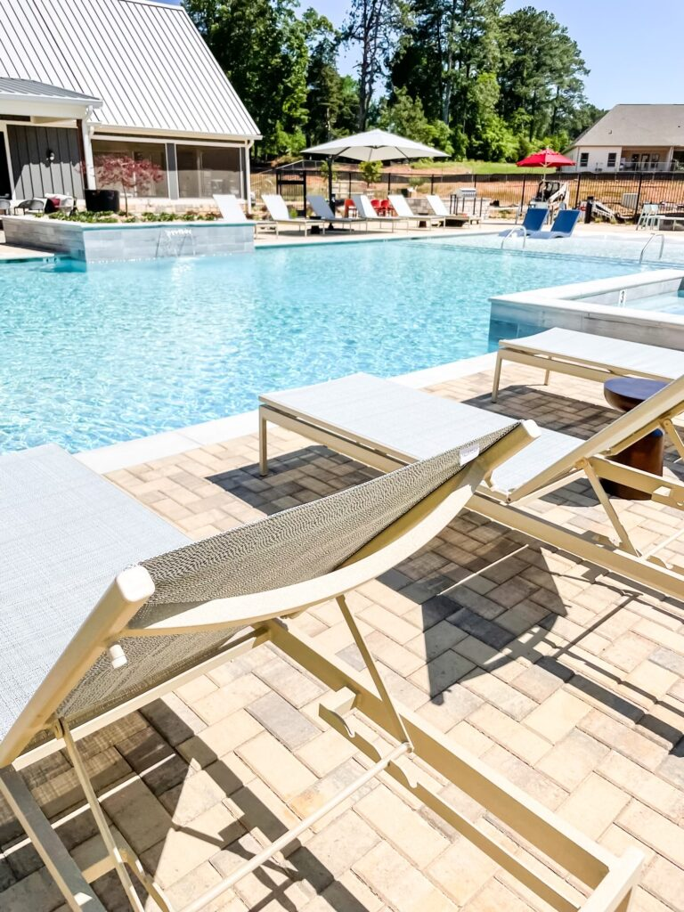 All About FarmHaus by Watermark in Madison, Alabama | Our pool is absolutely gorgeous. We have a hot tub, a clubhouse with a coffee bar, a 24/7 gym with first-class equipment, and so much more to come.